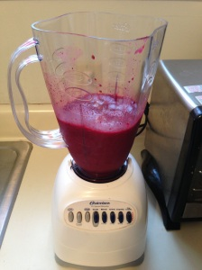 Blended berry and banana fruit smoothie