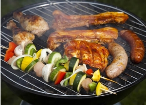 Chicken, brats and vegetables on the grill